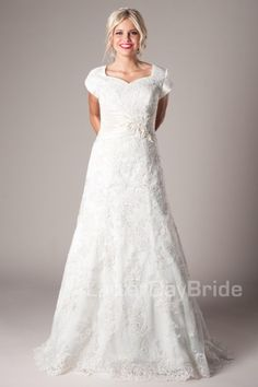 Bentham   Modest Wedding Dress   Modest Wedding Gown   LatterDayBride   LDS   SLC   UT   Salt Lake City   Utah   Worldwide Shipping   Lace appliques make this gown absolutely breathtaking. The slim, A-line fitted gown features a sweetheart neckline, satin ruched waistband, and Swarovski crystals. Gown available in Ivory, Ivory/Light Gold (as shown) or White.