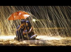 Great photo taken with a slow shutter speed so that it looks like it�s raining sparks.