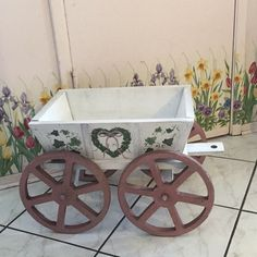Cute antique wheel barrow with hand painted heart wreath made from wood. ( price is firm) ( 19.5 L & 10w & 5D )... image 1