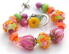 SALE Pink  Orange Flowers Lampwork Bracelet, Roses Lampwork Beads, Tulips, Green, Yellow Floral Spring Easter. $89.00, via Etsy.
