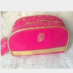 Juicy Couture NEW Cosmetic Case GREAT GIFT  Juicy Couture NEW Cosmetic Case Hot Pink & Gold Star design around zipper & Star zipper pull  black & gold star print inside. Never used hard to find was gift with perfume purchase 2 available. FASt SHIP.  Will ship next day or sooner!!!! Juicy Couture Bags Cosmetic Bags & Cases