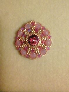 I made this pendant with 6mm milky pink fire polished beads, 4mm rose 2xab Swarovski crystal bicones, and 15/0 and 11/0 seed beads.