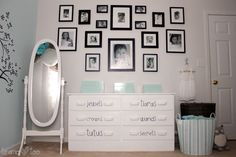 Black and white gallery wall over dresser in a nursery - love the look!