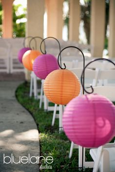 "Line a garden path or a sidewalk for your next party with paper lanterns on shepherd's hooks. Easily add a light kit for ambient light too. These are probably 8"" lanterns: http://www.partylights.com/Lanterns/8-in-Paper-Round"