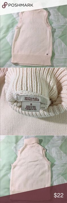 "Michael Kors turtleneck Ribbed Sleeveless top Michael by Michael Kors knit sleeveless turtleneck sweater top, size Small. Cream colored.   Gently used, pre-owned, in good condition. Please check photographs for more condition details.   Measured flat: Armpit to armpit: 14.5"" Length: 22""  Please feel free to contact me with any questions or concerns. Thanks for looking! MICHAEL Michael Kors Sweaters Cowl & Turtlenecks"