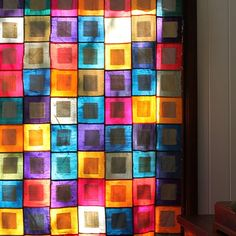 I made this silk quilt many moons ago but didn't use it so I took the back and wadding off and hung as a gorgeous 'stained glass' curtain x