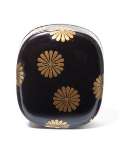 A BLACK LACQUER NETSUKE By Koma Kyuhaku, 19th century Sold for £ 2,375 (US$ 3,339) inc. premium THE EDWARD WRANGHAM COLLECTION OF JAPANESE ART Part III 15 May 2012