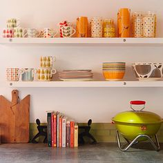 Decorate open shelving with bright Scandinavian-style dishes in the kitchen
