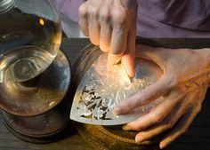 Silversmith. Colonial Williamsburg. Practiced hands create an ornate piece.