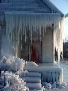 Here's something to make you Mid-Atlantic-ers feel warmer: A photographer and architect have recently sprayed an abandoned house in Detroit, Michigan with water, which froze into sheets of ice, in order to represent the nation's (and especially Detroit's) housing crisis