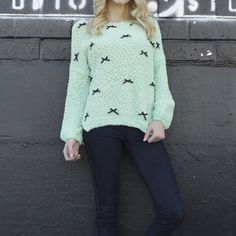Long sleeves woolen top Mint color woolen top with ribbon embellishments.  Tag says M/L. Also available in size S/M. Tops Sweatshirts & Hoodies