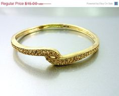 20% OFF - HUGE SALE Monet Gold Tone Vintage Bracelet Cuff Bangle with topaz rhinestones. on Etsy, $12.00