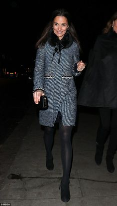 Pippa, 33, wrapped up warm in a blue tweed coat from Matthew Williamson with pearl trimmin...