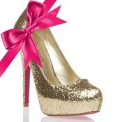 gold heels with a pink bow