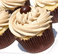 vanilla cupcakes with coffee buttercream frosting and a chocolate covered coffee bean on top, thinking about making these today