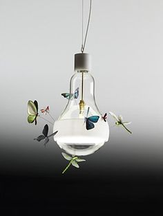 Ingo Maurer, industrial lighting designer must have been thinking about spring when he created this pendant. Good-bye winter, hello butterflies!