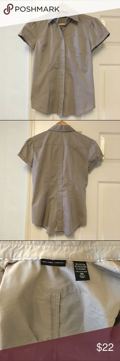 New York & Co. Button Down Shirt Stretch short sleeved button down shirt, with slightly puffy sleeves. Puffy sleeves seen a lot on Valentino's 2016 and 2017 runway shows. Worn a couple of times, in a great new-like condition. 60% cotton, 35%polyster and 5% spandex. Machine wash cold. Might fit small too. Ask me if you need measurement. 😊 New York & Company Tops