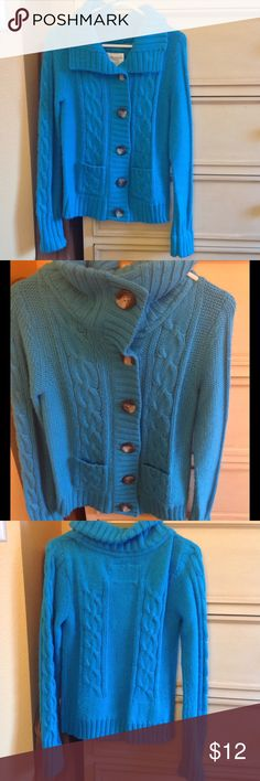 Blue button down knit jacket Blue knit jacket with front buttons. Option to button up in to a turtleneck. Fold-over collar. Size Large. From Aeropostale. Aeropostale Jackets & Coats