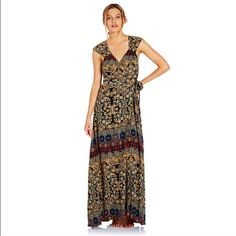 Tigerlily Zakhar wrap boho tribal maxi dress. Sz 6 Early Eastern European print inspired from Persian and Byzantine influences. Fixed gathered tunnel design at front with Tiger Lily czech glass button opening.    Wrap style maxi dress with cap sleeves and cut out back.     Fabric is 100% silk sand washed crêpe de chine. Color is Sea Emerald. Model is 173 cm. Dress is in excellent like new condition. Please feel free to ask any questions ❤️⛵️⛺️ Tigerlily Dresses Maxi