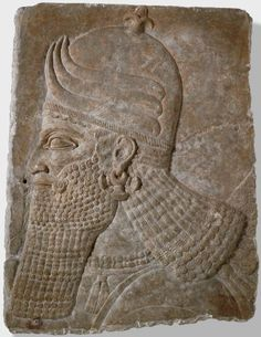 Fragment of a Wall Relief: Head of a Winged Genie, 883-859 BC Sculpture , Relief Neo-Assyrian , 9th century BC Neo-Assyrian period, c.883-612 BC Creation Place: Assyria Alabaster