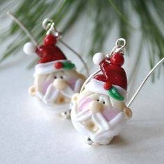 Santa Claus Earrings, Christmas Earrings, Lampwork Glass Earrings, Holiday Jewelry by bstrung on Etsy https://www.etsy.com/listing/213268674/santa-claus-earrings-christmas-earrings