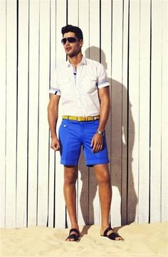 Shop this look for $92:  http://lookastic.com/men/looks/white-shortsleeve-shirt-and-yellow-belt-and-dark-brown-sandals-and-blue-shorts/2657  — White Shortsleeve Shirt  — Yellow Leather Belt  — Dark Brown Leather Sandals  — Blue Shorts
