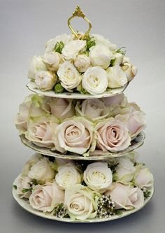 Rose arrangement on a cake stand - Our painter and decorator services in Manchester - Flower shop Blackpool | Wedding Flowers