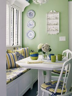 Breakfast Room Color  One banquette, a table, and a couple of chairs are all it took to transform a seldom-used kitchen corner into an eye-catching breakfast nook. Bright colors create a cheery atmosphere. Sparkling white furniture and trim balances the bold greens, yellows and blues.