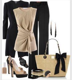 Black pants sweater tan blouse.