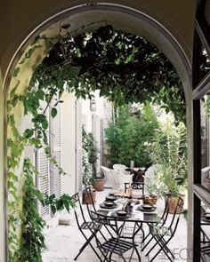 At a restored 16th-century house in Avignon, a wrought-iron table and chairs by Hervé Baume exude classic French flair via ED
