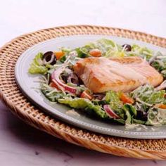Salmon Salad This homemade creamy garlic-lemon dressing recipe is healthful with creamy plain yogurt. Tossed with greens and topped with grilled salmon, this one-dish recipe is worthy of serving to guests.