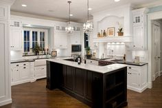 black island with white tops/ white cabinets with black tops