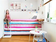 Princess-and-the-pea-bed has been covered with fabric to create the illusion of mattresses stacked on each other.