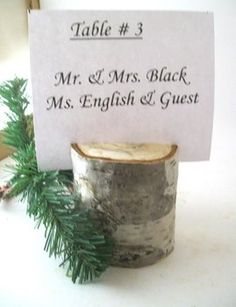 Cute tree-cutting and pine sprig placecard holder. Perfect for an outdoor or rustic event.