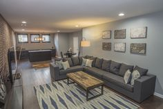 Recreation Room - Great space to entertain the family and guest.  Upgraded flooring, additional cabinets, and brick wall veneer.