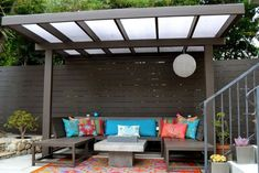 Photo: Polycarbonate ceiling - 10 x 12 Modern, contemporary fence, bench and pergola