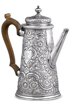 This silver coffee pot by John White is a stunning example of early Georgian silver. The entire pot is covered in exceptional floral chasing, engraving and repoussé work. White's pieces are known for the scarcity and exceptional quality. Early 18th-century English silver such as this is incredibly rare on the market ~ M.S. Rau Antiques