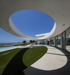 Completed in 2014 in Luz, Portugal. Images by Fernando Guerra | FG+SG. Elliptical House is the result of an idea. It is based on a geometric shape and a volume sculpted by the landscape.   A balance was sought between...