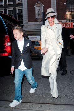 November 2008, Victoria Beckham in a Marc Jacobs coat taking son, Brooklyn, to see Jersey Boys in NYC