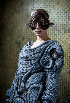 LuctoStefanie Nieuwenhuyse.  Grab the Sweater. Lose the headpiece.
