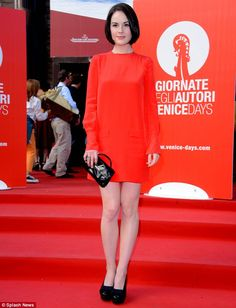 Well, she is a Lady: Downton Abbey's Michelle Dockery stands out at Venice Film Festival in red dress and her sleek dark bob