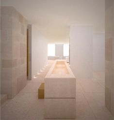 Kanye West's apartment, open space in New York by Claudio Silvestrin, monolithic stone island as a bathtub