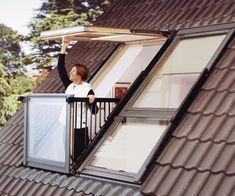 "This skylight window transforms into a rooftop balcony in seconds. Watch the rain pour down on a cozy night or enjoy the breeze and sunbeams on a warm summer's day. Velux's ""Cabrio"" transforming roof window is the pinnacle of skylight luxury."