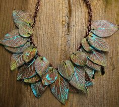 Leaves copper and patina polymer clay necklace. .