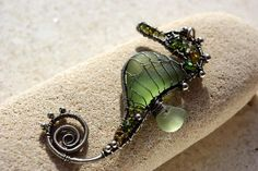 Tiny OLIVE seahorse wire wrapped seaglass pendant. by palmeras