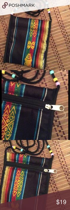 "Tribal Print Boho Passport Bag Boho People Free Spirit Tribal Passport Bag NEW This tribal pouch is perfect for travel for your passport or just hanging out and can be used in a myriad of ways.  • Zip closure compartment  • Padded & fully lined  • Vibrant Colors with a tribal print  • Approx 6.5"" x 6"" with a strap drop approx 20"" • Please review all actual photos which fully describes the item.  Colors may not be the same as you have on your screen  • Imported Handmade Bags"