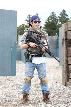 Airsoft Player in Japan. Fashion Photo. Plate carrier and Denim. Style - DEA. Military. Gun. Combat