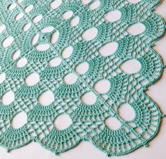 Crochet Doily Centerpiece, By Artistic NeedleWork Express your individuality in a world of mass-produced merchandise! This square doily is newly made using the highest quality #10 mercerized pearl cotton. Done in Aqua, this piece measures 15 inches square and has a wonderful