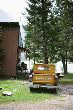 Vintage Chevy truck by a lakeside cabin in Stehekin, Washington. Vacation destination.