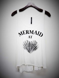 A personal favorite from my Etsy shop https://www.etsy.com/listing/289696081/mermaid-at-heart-tank-top